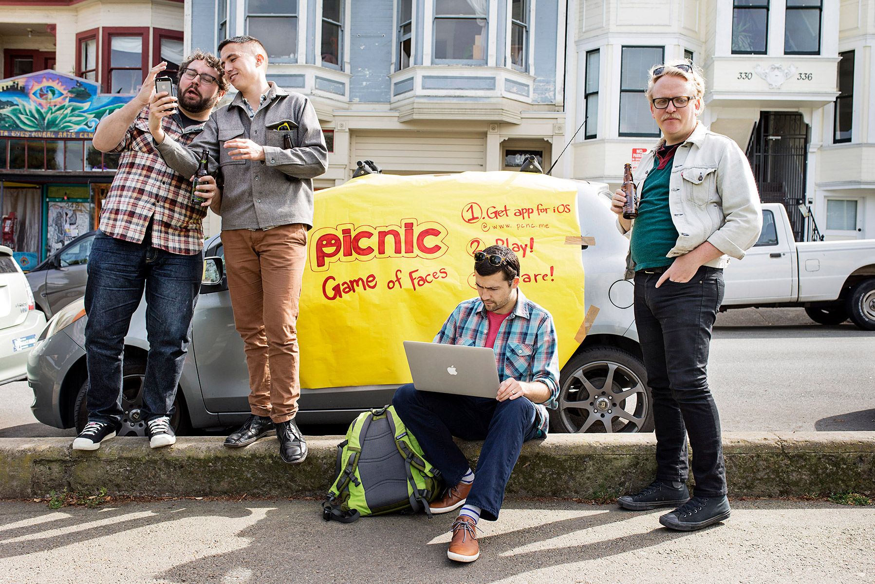 Andrew Hines, center, works on trying fix a problem during a beta launch party for his app Picnic with his co-founder Cassidy Clawson, second from right, at Precita Park in San Francisco, California in March 2015. Picnic is a game that involves taking selfie photos in response to challenges to act out certain emotions. The launch had to be postponed after the co-founders realized the app wasn't working because Apple's TestFlight program, which was necessary for the beta testing, was down and not working that day.