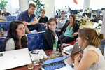Danielle Gaglioti, center, talks with her co-worker Mackenzie Hughes, right, and their intern Sandy Frank during a happy hour event at the co-working space Hatch Today in San Francisco, Calif., in August 2014. They were working out of Hatch Today for the summer on their company Akimbo while participating in Tumml, an urban venture accelerator program. Co-working spaces are popular with smaller start-ups, both as a way to keep office costs down and to be surrounded by a community of other entrepreneurs.