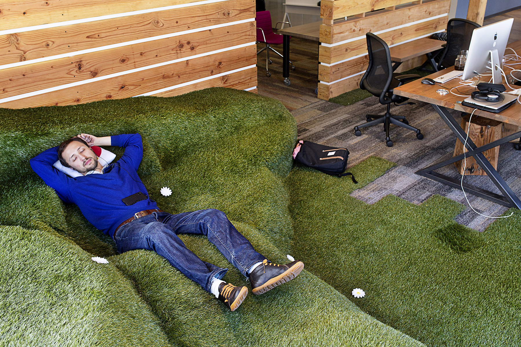 Lev Konstantinovski takes a nap on a break from the data science program he was attending at the co-working space Galvanize in San Francisco, Calif., in March 2015. Galvanize, a hybrid company that combines tech office space with a school, has several campuses around the country in addition to the one in San Francisco. The campus is themed around San Francisco parks, including this common area, which is built to resemble Dolores Park.