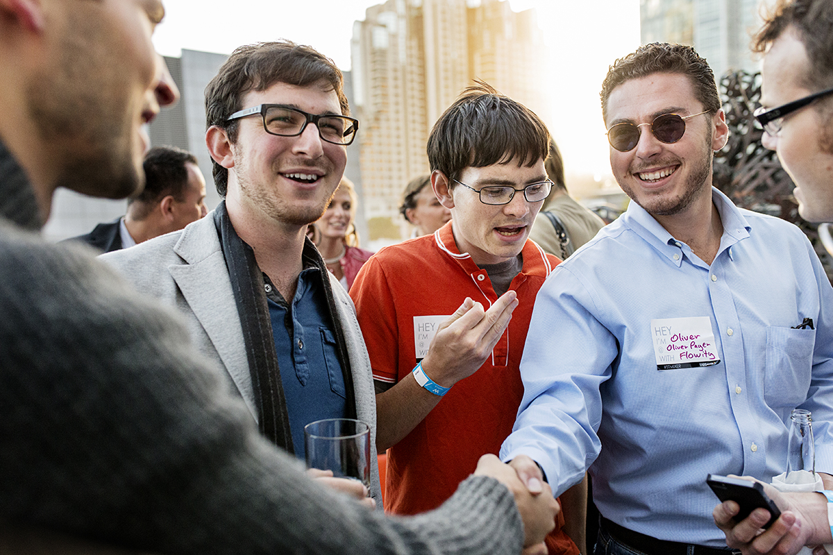 Noah Levenson, Nick Cole and Oliver Page (left to right) mingle with other attendees of the Startup and Tech Mixer, a tech industry networking event, at the W Hotel in San Francisco, Calif., on Friday, August 8, 2014. The event, which is held once every few months, draws hundreds of attendees.