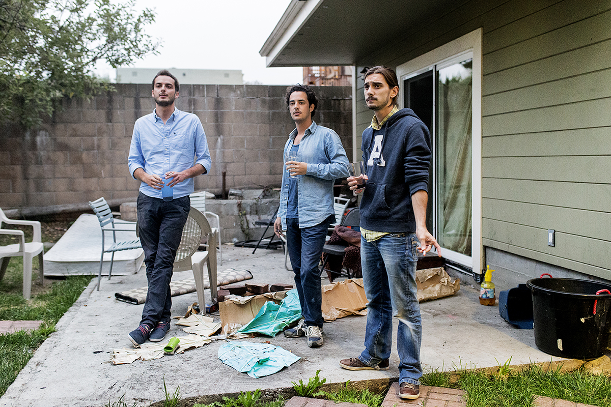 Adrien Thibodaux, Lyrod Levy and Adrien Chometon (left to right), all co-founders of Weeleo, take a smoke break in the backyard of a fraternity house where Levy and another co-founder were sleeping that evening in Berkeley, Calif., on Monday, August 18, 2014.  The four co-founders of the company were in San Francisco from France for the summer to participate in an accelerator program.  To save money Levy and their fourth co-founder couch surfed for the summer instead of renting an apartment.