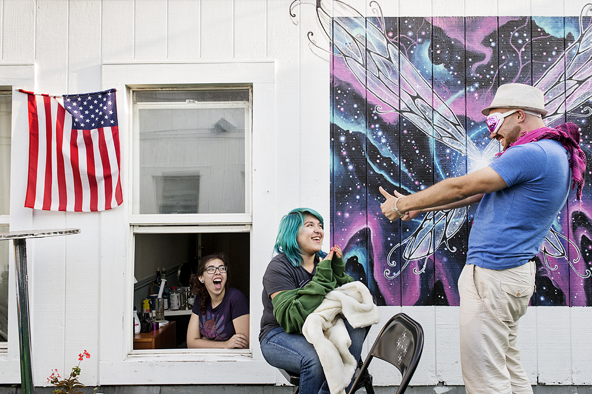 Adonis Gaitatzis (right) tries on costumes for Burning Man with his 20 Mission housemates Angela Van Den Eeden (left) and Vivien Castillo (center) while packing and preparing to head to the festival at the co-living space in San Francisco, Calif., on Monday, August 25, 2014. Around 40 people live in the building, which is a former single room occupancy hotel that had been vacant for several years before being turned into the co-living space.  Many of the residents, such as Gaitatzis, are start-up entrepreneurs and the community is a mix of temporary occupants with people who have made the space their home on a more long-term basis.