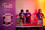 Mohammed Alkadi, Albara Hakami and Abby Wischnia (left to right) host a booth for their company Feelit, a social app to help people express their feelings and emotions, during the Startup and Tech Mixer at the W Hotel in San Francisco, Calif., on Friday, March 27, 2015. The networking event, which draws hundreds of people from the tech industry, is held every few months.