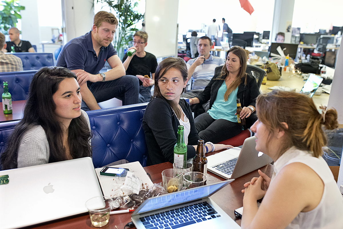 Danielle Gaglioti (center) talks with her co-worker Mackenzie Hughes (right) and their intern Sandy Frank during a happy hour event at the co-working space Hatch Today in San Francisco, Calif., on Wednesday, August 27, 2014.  They were working out of Hatch Today for the summer on their company Akimbo while participating in Tumml, an urban venture accelerator program.
