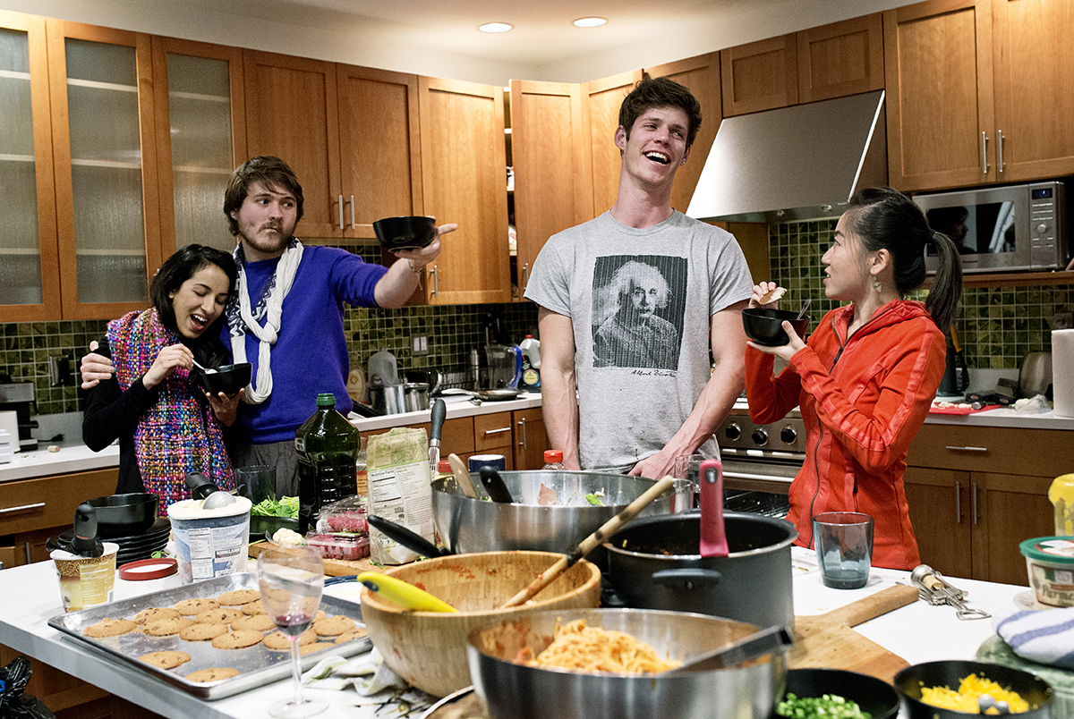 Noor Siddiqui, Conor White-Sullivan, Dylan Enright and Karen X Cheng (left to right) eat dessert during a dinner party hosted by the company WeFunder at their office in San Francisco, Calif., on Wednesday, February 4, 2015.  WeFunder is a crowdfunding service that connects start-ups and investors through the internet.  The company and it's founders throw large dinner parties almost every Wednesday for friends and guests from the industry at their office, which also serves as the home of several company employees.