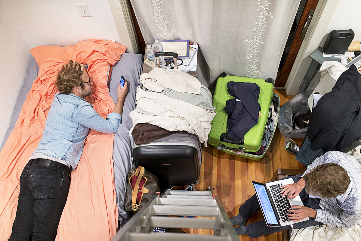 Raphael Dardek (left), a co-founder of Weeleo, relaxes in the bed where he was temporarily staying at a fraternity house in Berkeley, Calif., on Monday, August 18, 2014.  Dardek and another co-founder spent the summer couch surfing in order to save money while in San Francisco from France to participate in an accelerator program.