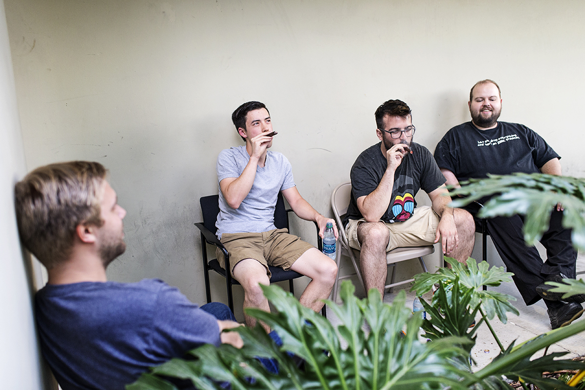 Connor McGill (second from right) smokes cigars with his co-workers on his last day of work at Hackers/Founders, an organization that helps early-stage entrepreneurs located in the Hacker Dojo in Mountain View, Calif., on Friday, August 29, 2014.  McGill was leaving his job to pursue an undergraduate degree at UC Davis.