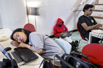 A participant in a hackathon organized by the company Shirts.io sleeps at her computer during the event at Citizen Space in San Francsico, Calif., on Saturday, August 16, 2014. Hackathons are events usually lasting a few days in which computer programmers and others involved in software and hardware development collaborate on a project over a set period of time, often while competing for awards and prizes. This hackathon lasted 37 hours and many participants stayed the entire time, taking breaks to sleep where and when they could.