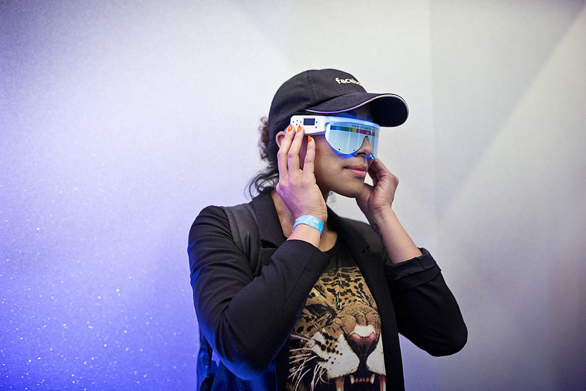 An attendee of the Startup and Tech Mixer tries on a product on display at while attending the tech networking event at the W Hotel in San Francisco, Calif., on Friday, August 8, 2014.  The event is held once every few months and draws hundreds of attendees.