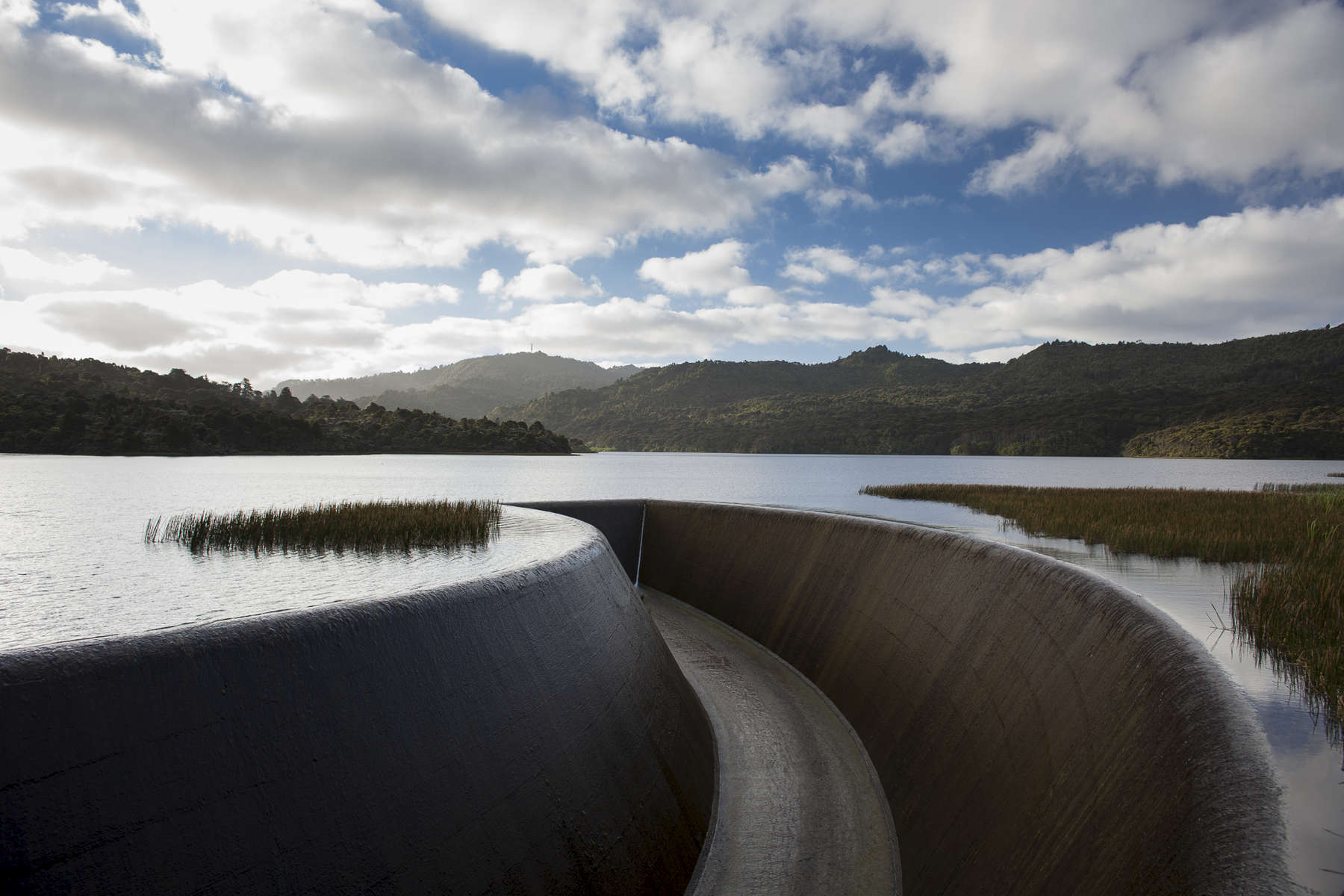 The Gordon Dam generates hydro-electric power in South West Tasmania, Australia.  Shot in Australia by Vermont photographer Judd Lamphere.