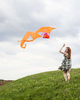 Woman flies a kite in the fall on a Shelburne hilltop. by Vermont photographer Judd Lamphere