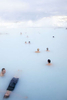 Tourists and visitors floating in Blue Lagoon waters in Iceland, by Vermont photographer Judd Lamphere