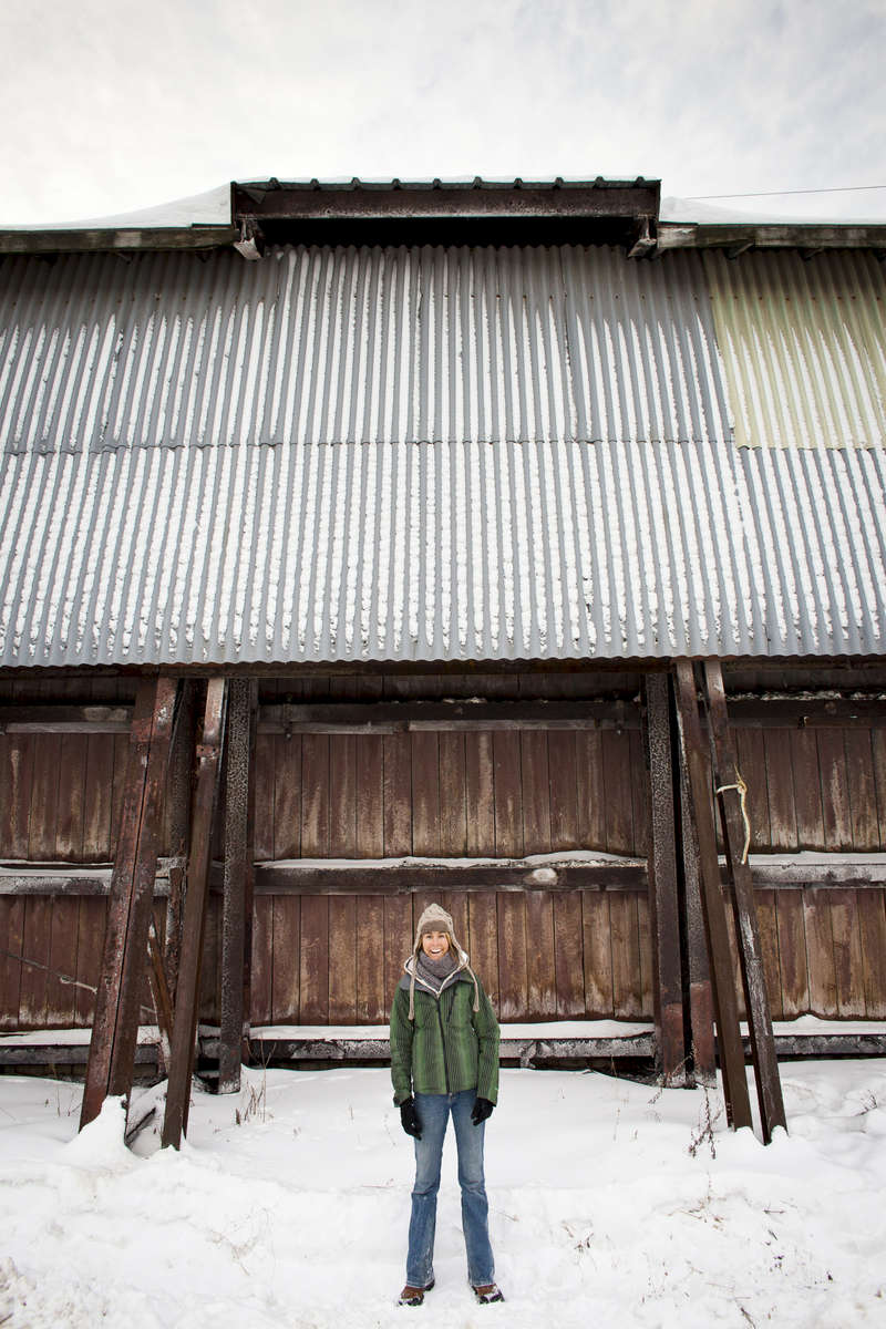 Smiling woman in winter in Burlington. by Vermont photographer Judd Lamphere