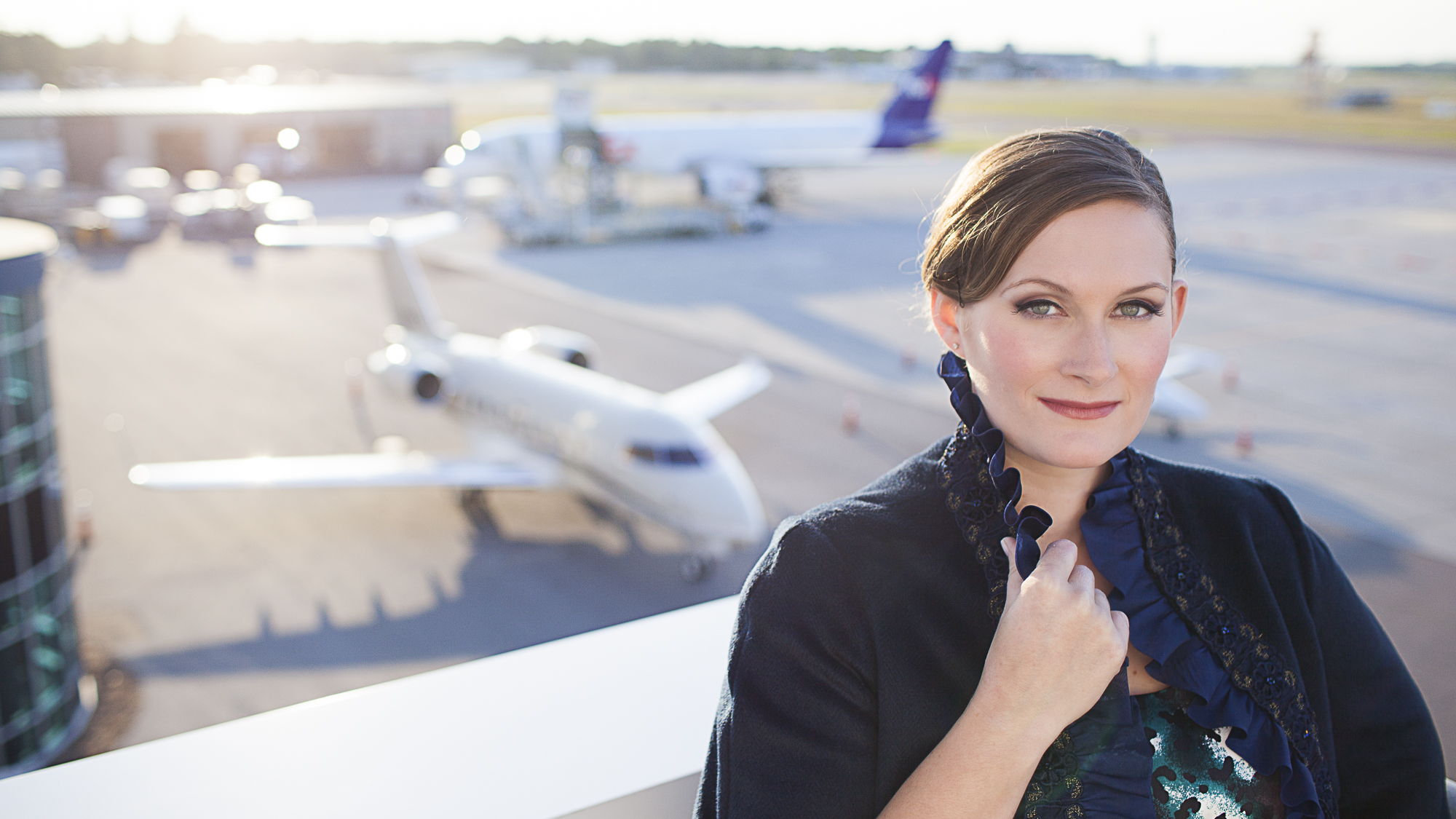 Portrait of woman in front of airplane  by Eve Event Photography