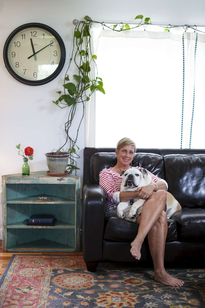 A woman and her english bulldog sit for a portrait in her home. Shot for a marketing campaign for Vermont Gas.