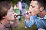 Sparks fly as family members light cigars at a wedding, by Vermont photographer Judd Lamphere