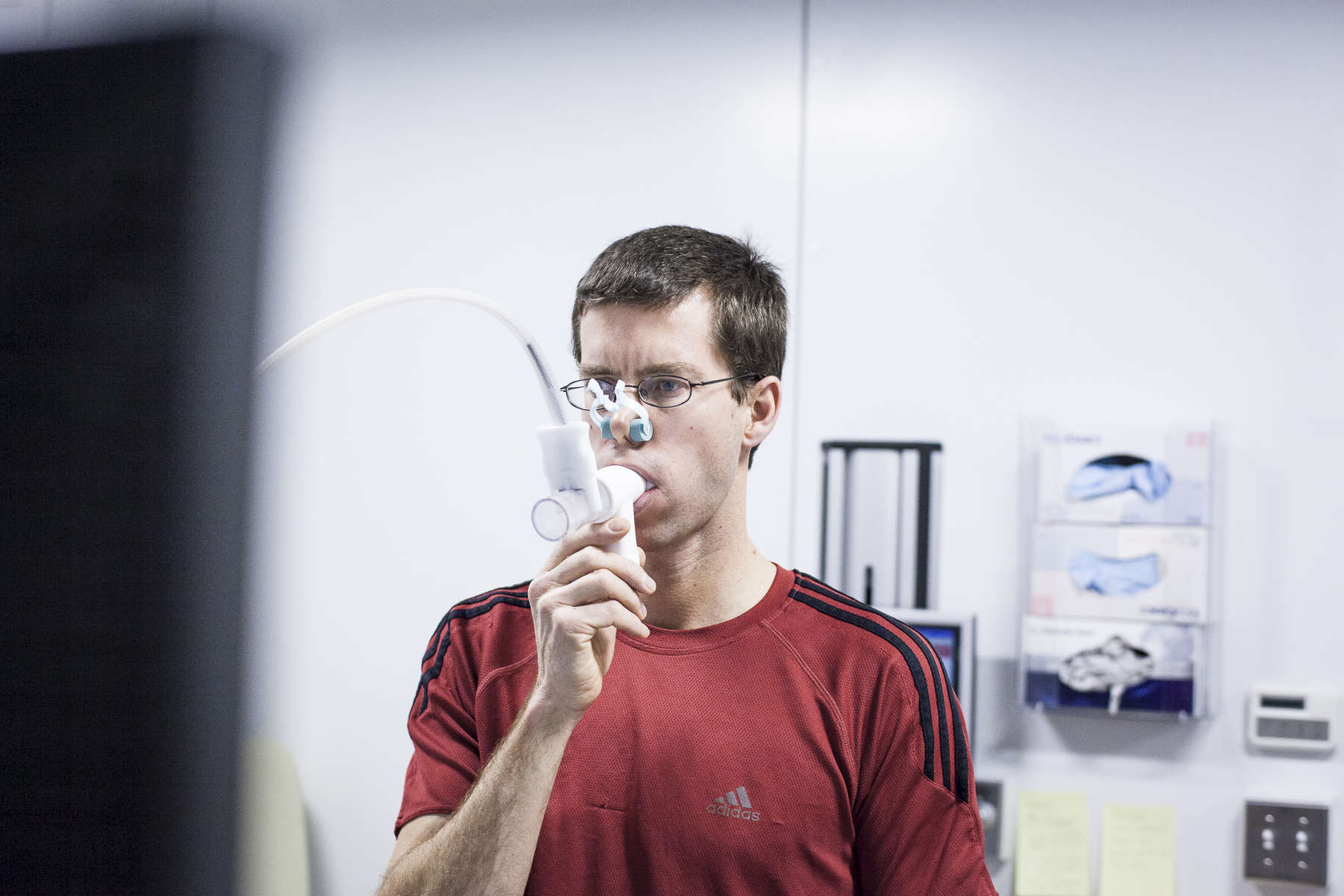 Writer Warren Cornwall does a lung test at Boston General Hospital before competing in a Triathlon. by Vermont photographer Judd Lamphere