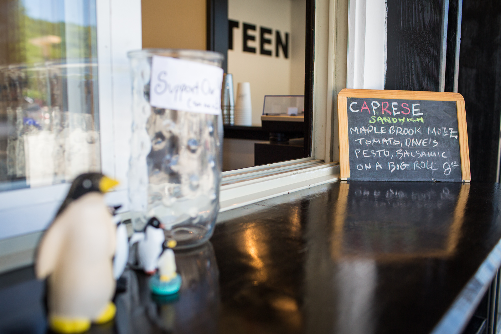 Kitsch and a chalkboard special of the day adorn the counter at Canteen Creemee Company in Waitsfield, Vermont on Thursday, June 23, 2016. Charlie Menard, longtime chef at Inn at the Round Barn, recently opened the creemee stand on Route 100.