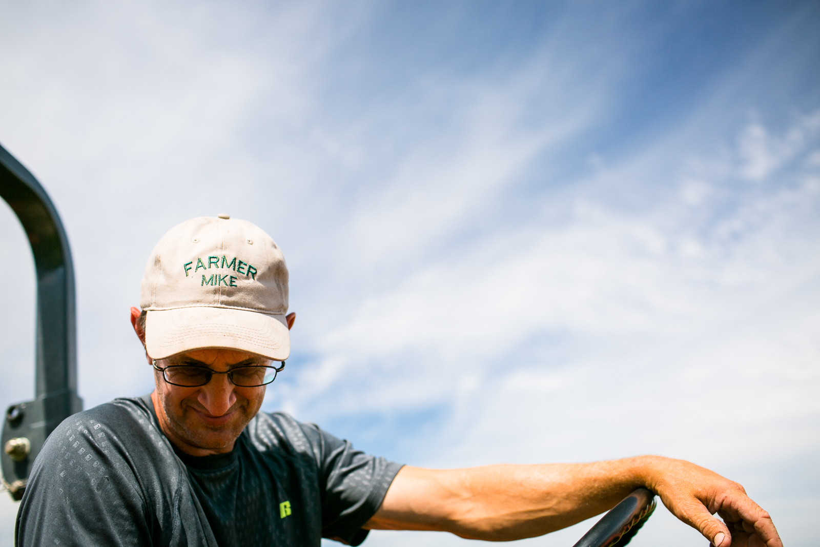 Mike Isham, {quote}Farmer Mike,{quote} shows off his hat at Isham Family Farm, a diversified farm in Williston, Vermont, on Tuesday, August 9, 2016.