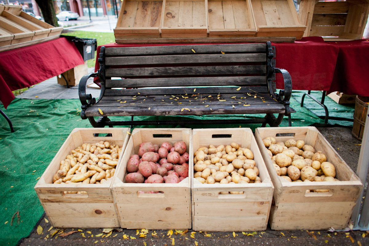 Crates of potatoes await buyers at the Burlington Farmer's Market, Burlington, Vermont.