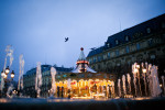 A carousel spins at dusk in Paris.