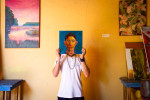15 year-old Nicaraguan artist Luis Carlos holds up a self-portrait, Granada, Nicaragua.