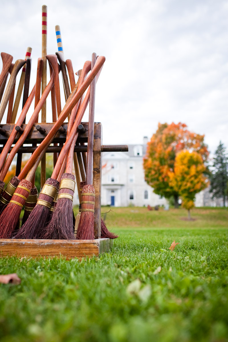 A line of broomsticks on the field at Middlebury College before a quidditch game, Middlebury, Vermont.
