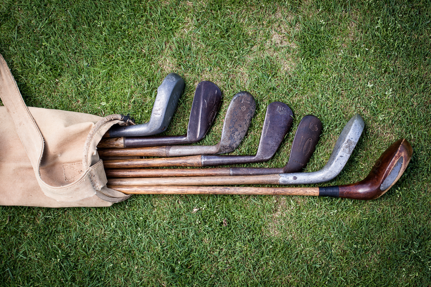 Hickory golf clubs on the green. By Vermont photographer Monica Donovan for Kingdom Magazine