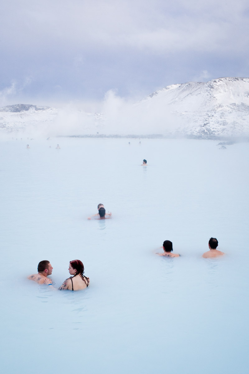 Visitors swim in the Blue Lagoon, a spa and major tourist attraction in Grindavik, Iceland. The Svartsengi geothermal power plant\'s waste water, after passing through a heat exchanger to provide municipal hot water, is fed into the Blue Lagoon.