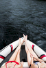 Two young women boating, Kezar Lake, maine. by Vermont photographers at Reciprocity Studio, Burlington
