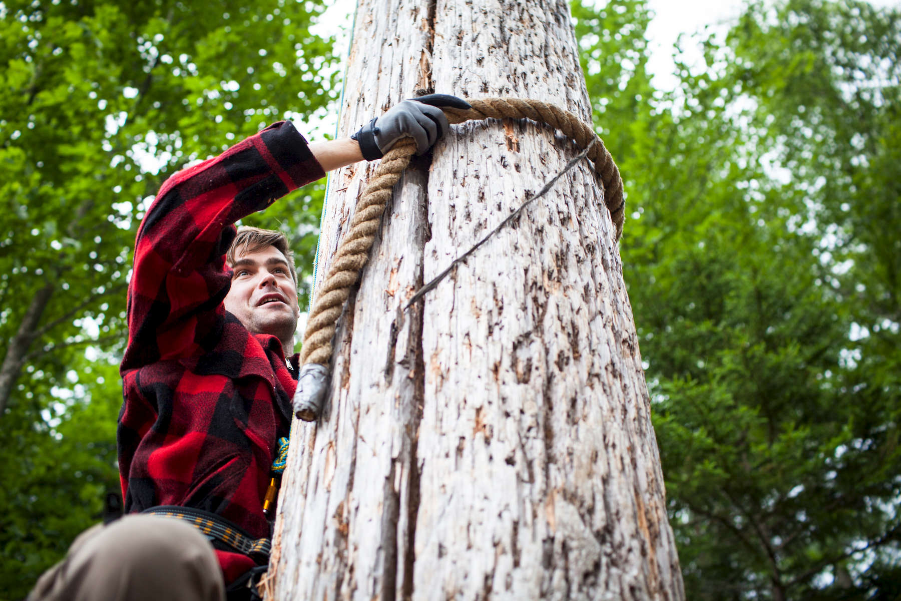 Martin Hemming log climbing while participating in the annual Adirondack Woodsmen\'s School at Paul Smith\'s College. by Monica Donovan for the Sunday Times