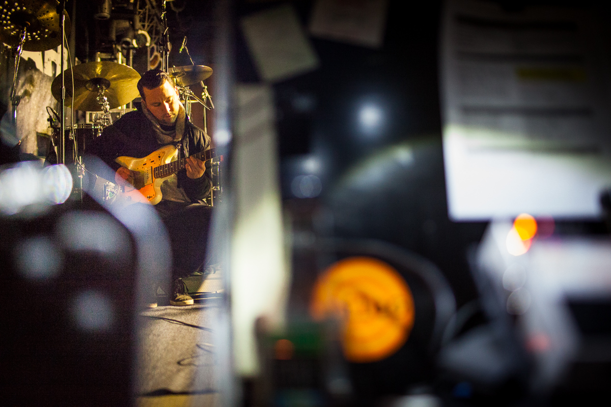 Guitarist Aaron Dugan tunes up before Matisyahu\'s performance at Higher Ground in Burlington on December 16, 2014. By Vermont Photographer Monica Donovan for Billboard Magazine