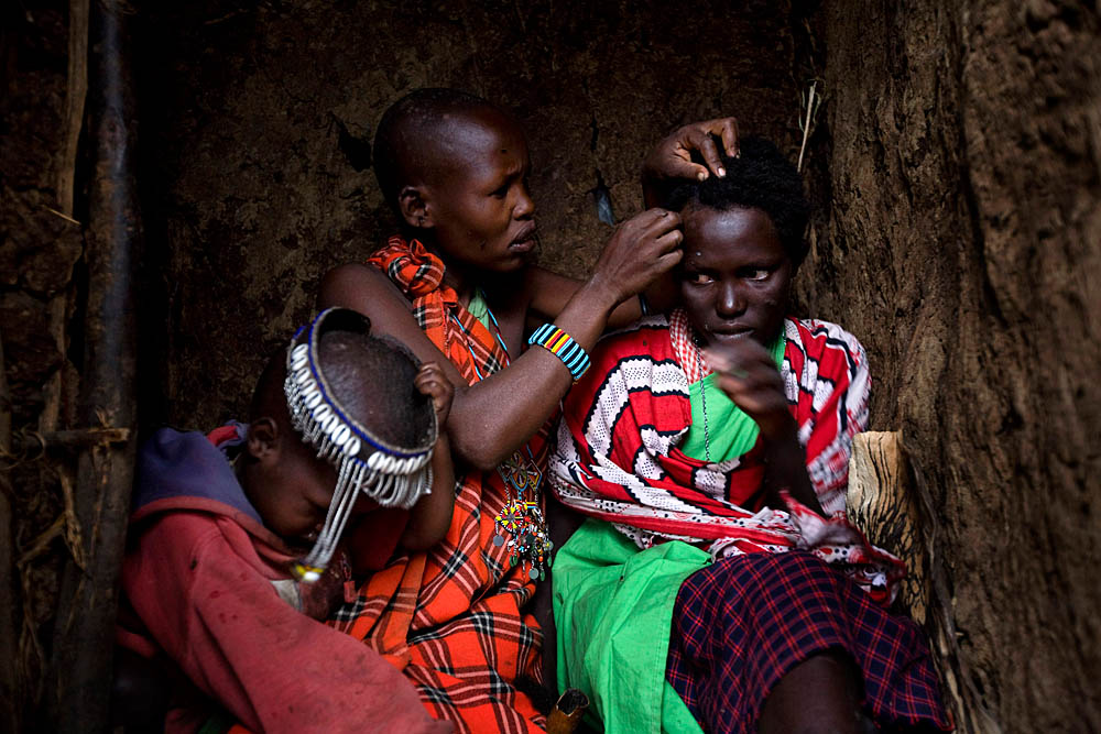 Naanyu Sekut cries while her head is shaved in preparation for her wedding day August 12, 2007 in Kameli, Kenya.