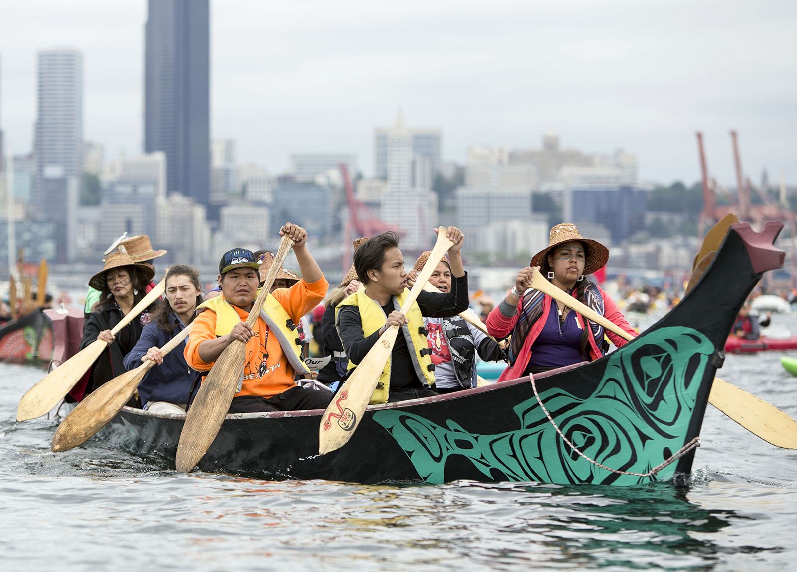 Swinomish Native Americas in a canoe, along with activists in kayaks protest Saturday, May 16, 2015, near the Polar Pioneer, Shell Oil Company's  drilling rig, which is moored at the Port of Seattle's Terminal 5