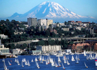 Photo by Ron WurzerView of Washington state's Mount Rainier looms over Seattle's Lake Union full of sailboats on a summer afternoon.