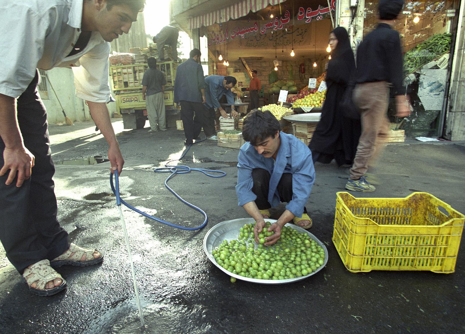 Fruit Vendor on a Tehran, Iran sidewalk. Photo by Ron Wurzer.