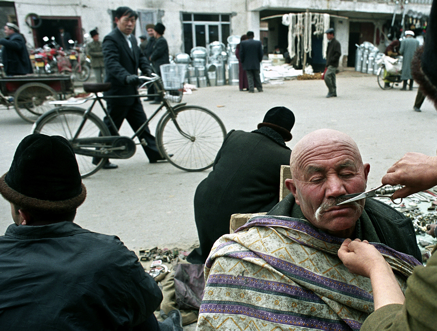 Market haircut and mustache trim, Kashgar, China