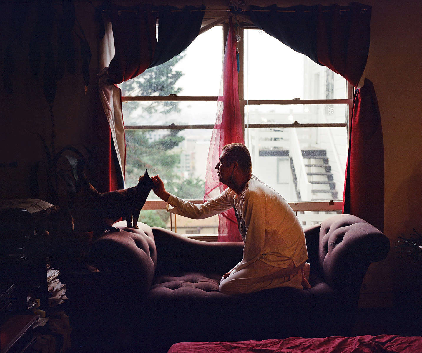 Jesus Guillen pets his cat in his apartment in San Francisco, Calif. on November 11, 2016. Guillen was one of the men featured in the Chronicle's first feature film called Last Men Standing about long-term HIV survivors.