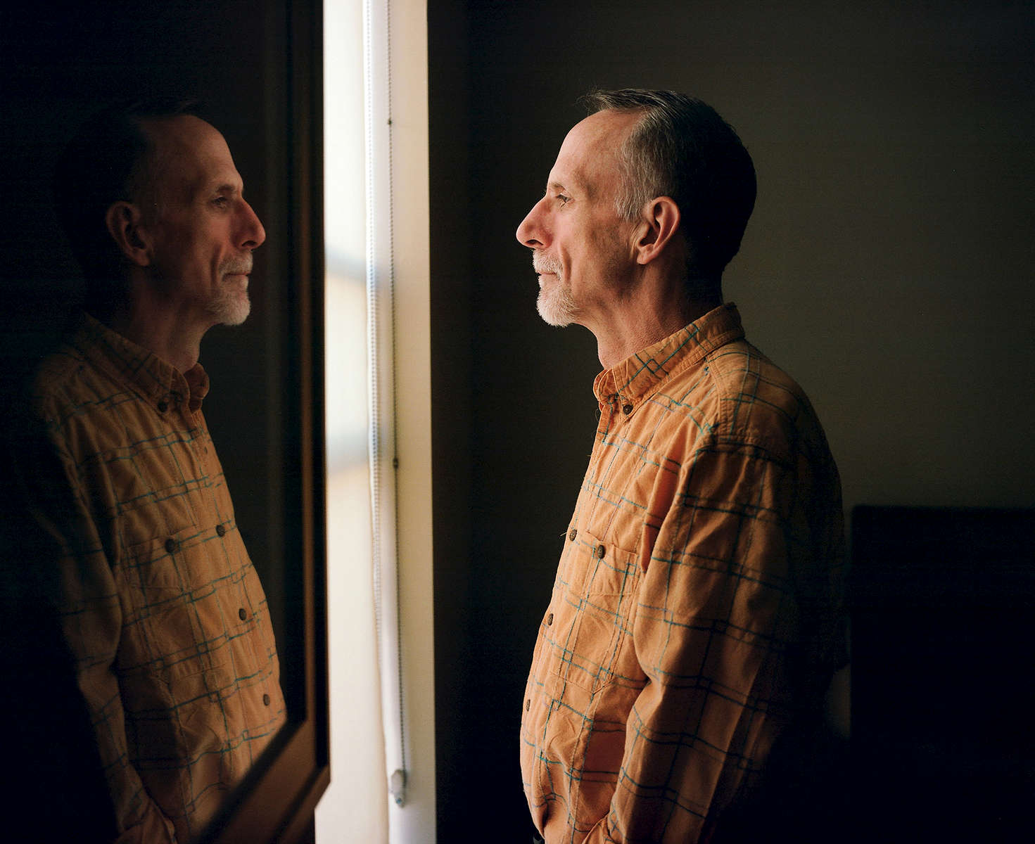 Kevin VandenBergh looks out the window of his new apartment in San Francisco, Calif. on November 23, 2016. VandenBergh was one of the men featured in the Chronicle's first feature film called Last Men Standing about long-term HIV survivors.