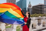 Oakland Mayor Libby Schaaf helps dedicate and raise a flag in honor of Gay Pride on top of City Hall on Thursday, June 22, 2017 in Oakland, Calif.