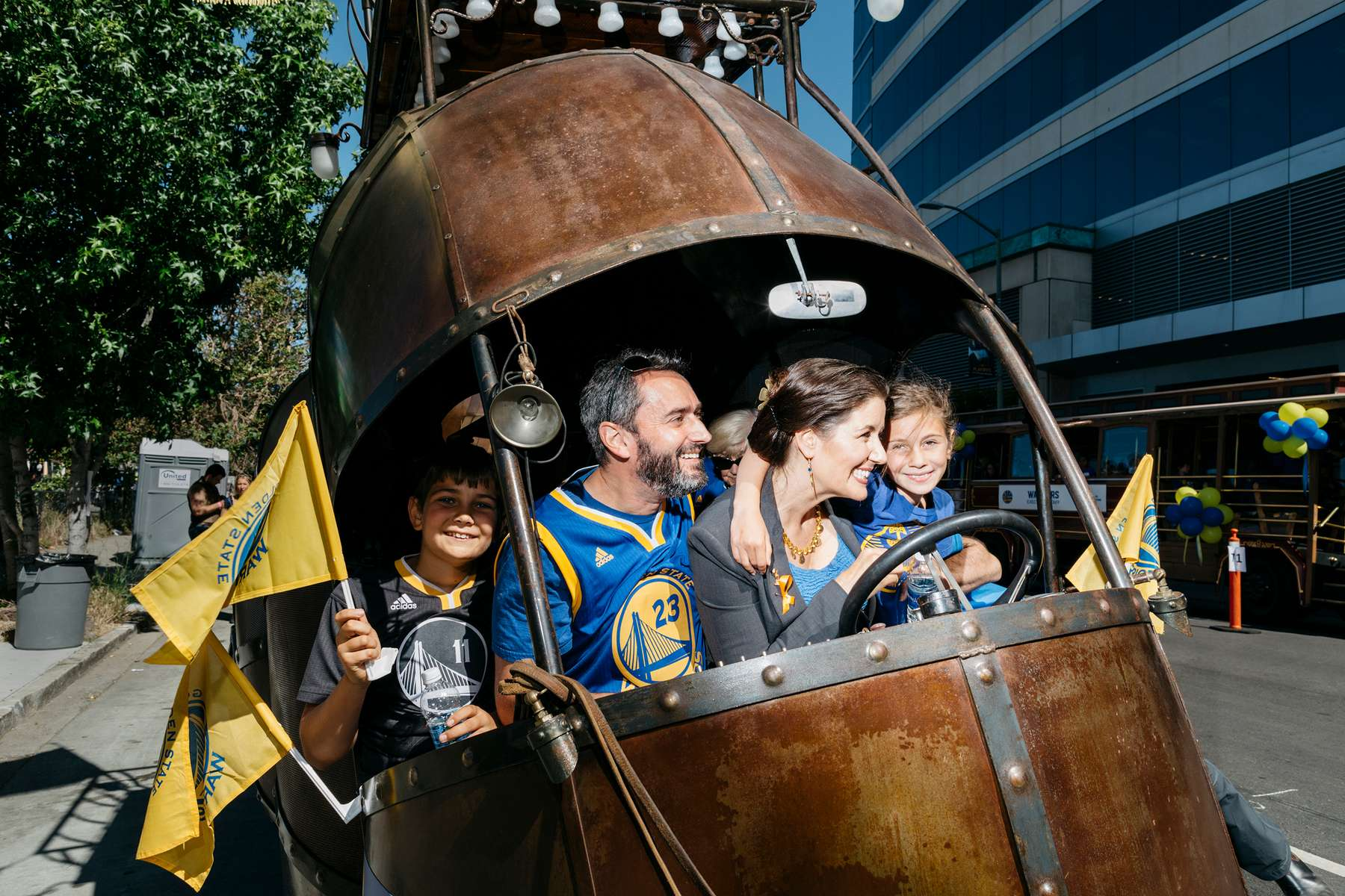 Oakland Mayor Libby Schaaf sits in 'The Golden Mean' snail art car with her husband, Sal (Salvatore) Fahey and children, Dominic, far left, and Lena before the start of the Warriors Championship parade on June 15, 2017.