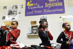 Members of the Hillcrest High Steppin' Majorettes and Drum Corps are fitted for their parade uniforms at the WRES radio station offices Wednesday evening.11-7-12 - Erin Brethauer (ebrethau@citizen-times.com)