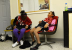 One of the youngest members of the Hillcrest High Steppin' Majorettes, Lonna Hayes, 6, takes a load off while others are fitted for their parade uniforms at the WRES radio station offices Wednesday evening.11-7-12 - Erin Brethauer (ebrethau@citizen-times.com)