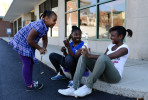 Lonna Hayes, 6, Ayana Benjamin, 12, and Kynasia Robinson, 12, laugh during a break in practice.  {quote}It's good exercise and it motivates you,{quote} says Robinson of the program.With just a week to go until the Holiday Parade through downtown Asheville, the Hillcrest High Steppin' Majorettes and Drum Corps practice all Saturday afternoon.11-10-12 - Erin Brethauer (ebrethau@citizen-times.com)