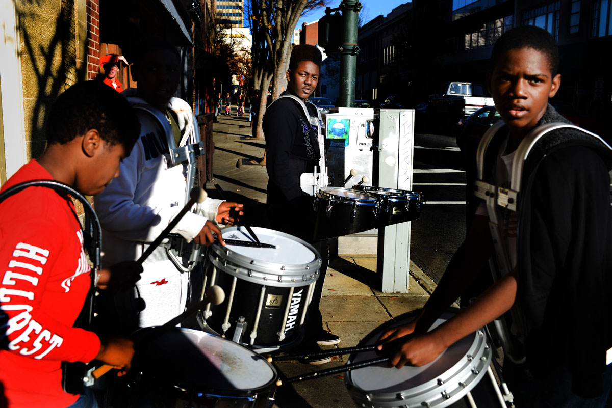Members of the drum corp including Ja'sean Falls, 11, Correy Williams, 14, Nick Blakely, 13, and James Lee IV, 14, wait to take the marching line back to the parking lot for practice after lunch.  With just a week to go until the Holiday Parade through downtown Asheville, the Hillcrest High Steppin' Majorettes and Drum Corps practice all Saturday afternoon.11-10-12 - Erin Brethauer (ebrethau@citizen-times.com)