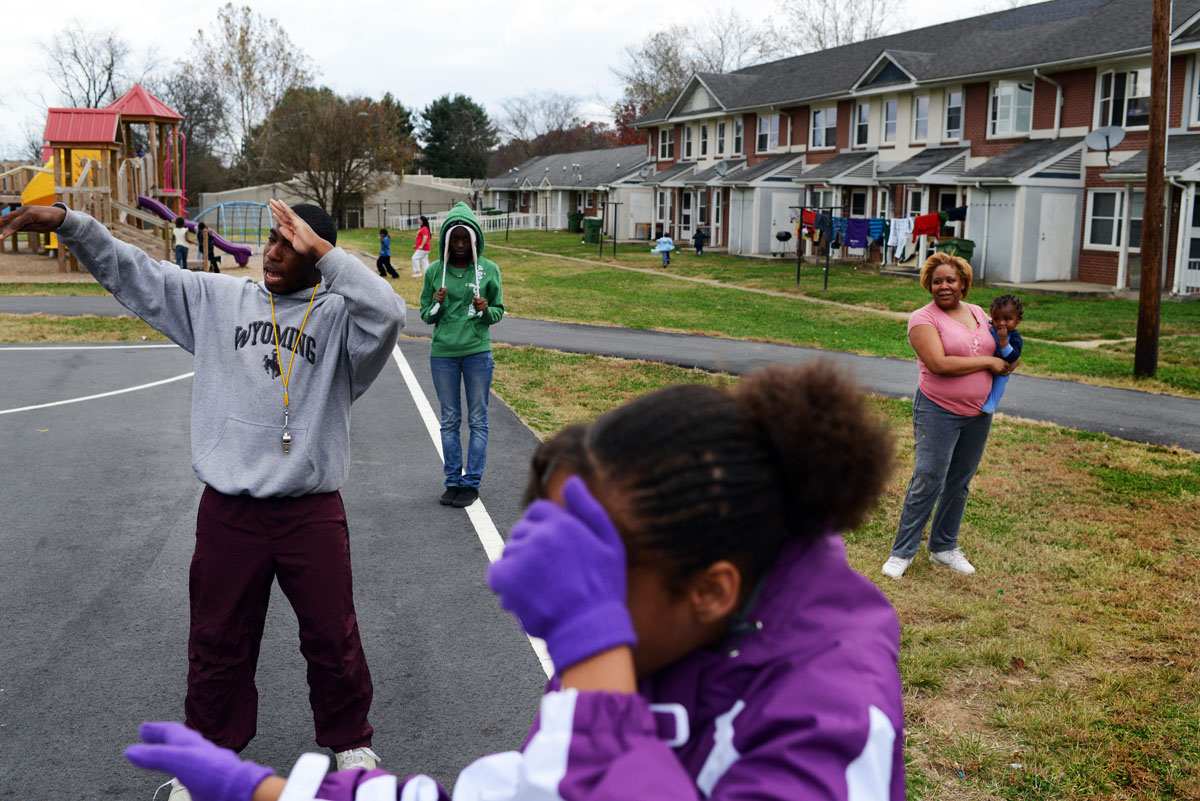 Drum major Rico Griffin, 20, left, leads a small group of younger Hillcrest High Steppin' Majorettes, including Chyna Jones, 10, through an extra practice at the Hillcrest Apartments complex Monday afternoon during a day off school.  Griffin took the bus to Hillcrest to lead the practice before the team's official practice later in the evening.11-12-12 - Erin Brethauer (ebrethau@citizen-times.com)