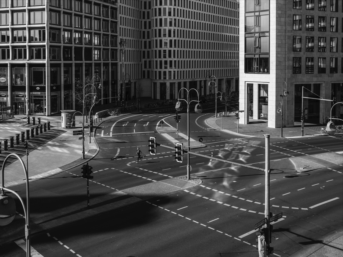 April 05, 2020 - Berlin, Germany: Pedestrians walk on the abandoned Kantstrasse Budapester Strasse crossing in the heart of West Berlin. This crossing was one of the busiest crossings in town before the shutdown.The coronavirus pandemic has hit Germany hard, with more than 100,000 people infected, but the percentage of fatal cases has been remarkably low compared to many neighboring countries. The German Council of Economic Advisers In a special report two weeks ago already  warned that a recession in Europe's powerhouse is inevitable. In a worst case scenario, output will shrink by 5.4%. the Experts predicted.