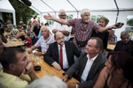 "August 08, 2017 - Landsberg, Germany: : SPD party candidate for chancellor Martin Schulz speaks at ""Am Pfarrberg e.V."" allotment with citizens angry on the coalitions migration policies. (Hermann Bredehorst / Der Spiegel / Polaris)"
