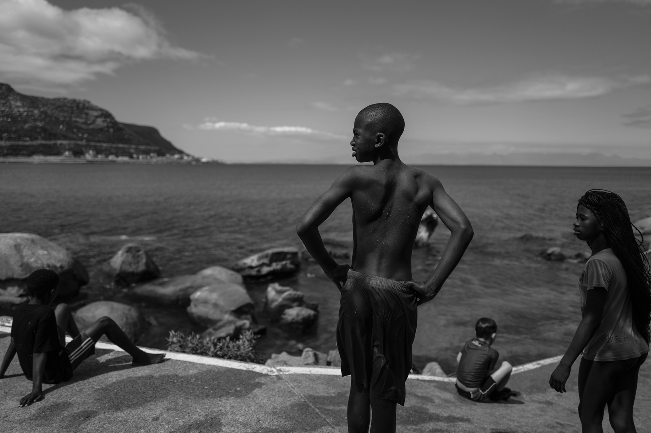 Fish Hoek, South Africa: Locals and tourists , the old and young enjoy beach life at Jager Walk.South Africa is according to TIME the most unequal country on the planet. A surge in Cape Town's murder rate has raised concerns that it could soon challenge for the unenviable title of the world's most dangerous city.