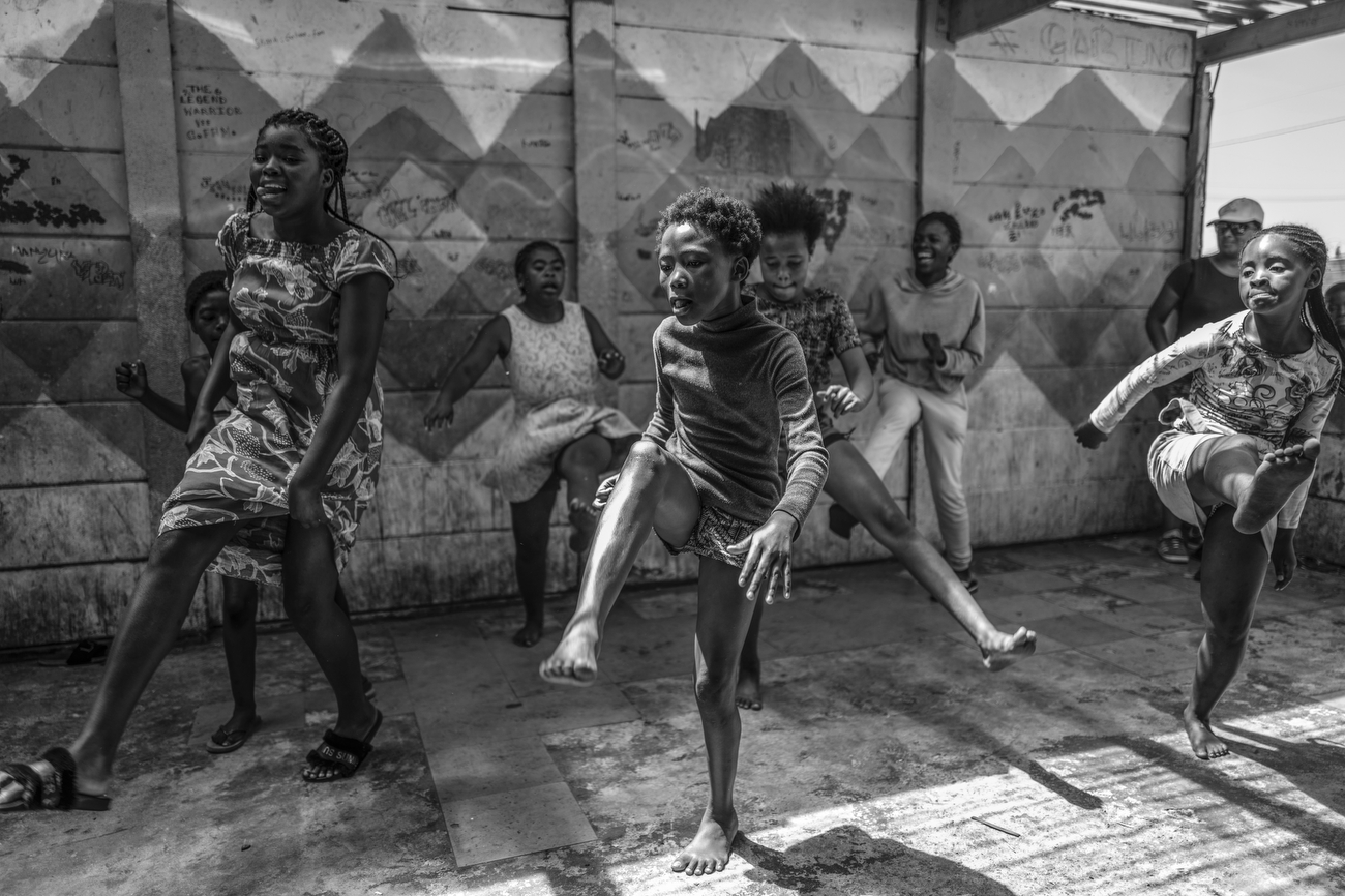Cape Town, South Africa: Kids dance at Happy Feet Youth Project in Langa. Langa is Cape Town's oldest township, established in 1923. About 1.5 million people live in townships within city limits. Happy Feet helps uplift local children through education, good nutrition, leadership and team building. This is possible through dance, after school assistance, a soup kitchen and different group events and performances..South Africa is according to TIME the most unequal country on the planet. A surge in Cape Town's murder rate has raised concerns that it could soon challenge for the unenviable title of the world's most dangerous city.January 12, 2020 - Cape Town, South Africa: Kids dance at Happy Feet Youth Project in Langa. Langa is Cape Town's oldest township, established in 1923. About 1.5 million people live in townships within city limits. Happy Feet helps uplift local children through education, good nutrition, leadership and team building. This is possible through dance, after school assistance, a soup kitchen and different group events and performances.
